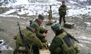 Russian soldiers prepare ammunition for mortar artillery in the mainly Muslim Northern Caucasus