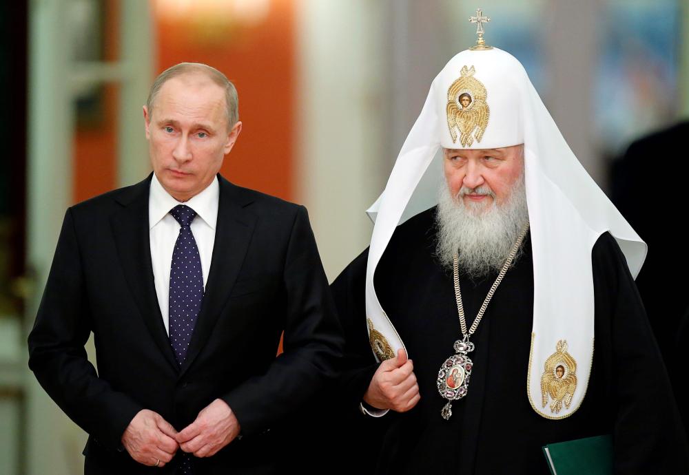 Presedintele rus Vladimir Putin și patriarhul Bisericii Ortodoxe Ruse Kirill, un tandem politic redutabil